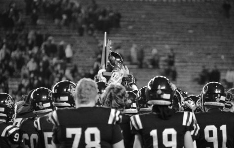 The Pirates raise their silver ball trophy after the state game on Nov. 22. Bay Port fell to Muskego 21-10. Photo by Mercy Gichobi